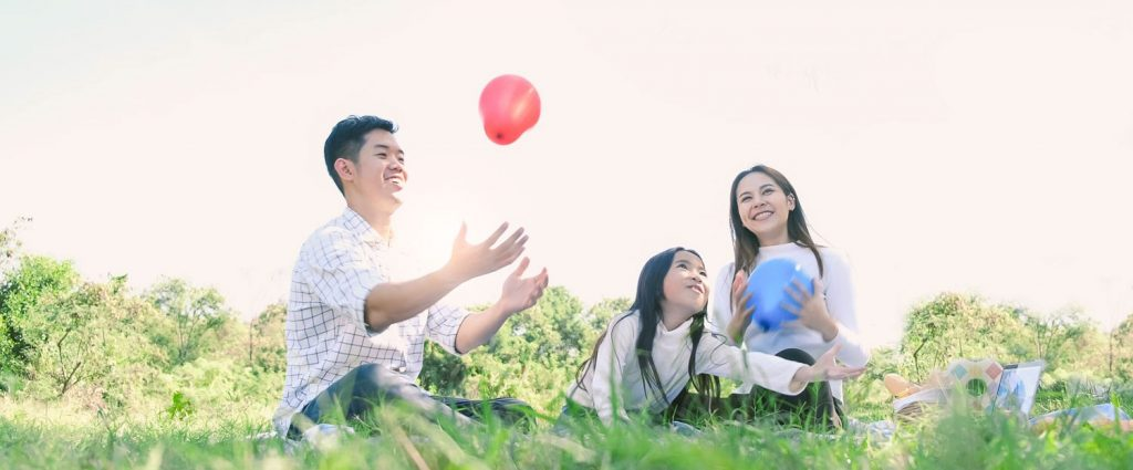 Outdoor Family enjoying picnic - golden haven memorial park